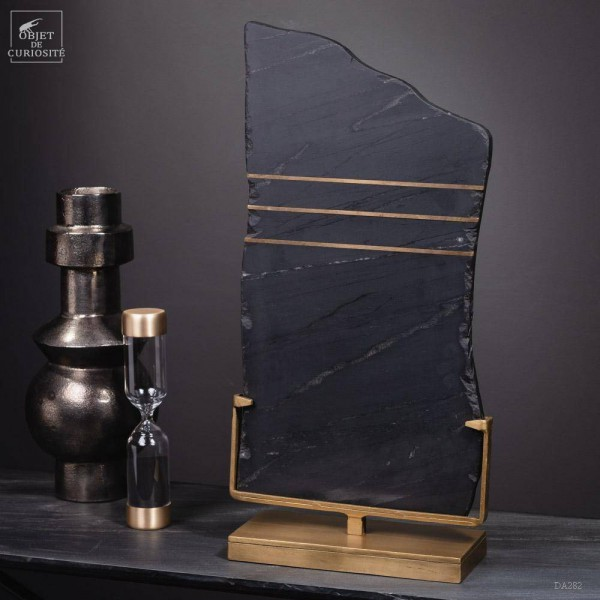 Black slate slab with crossed brass...