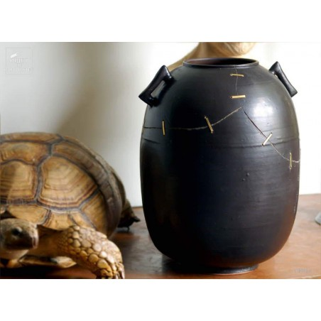 Repaired black vase