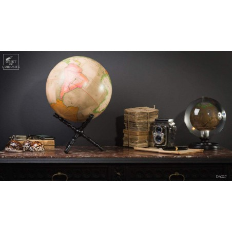 Pink earth globe on cross stand, 12 inches.
