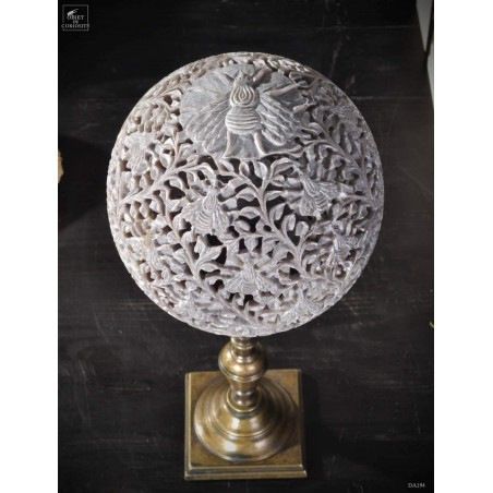 Carved stone with bees on brass