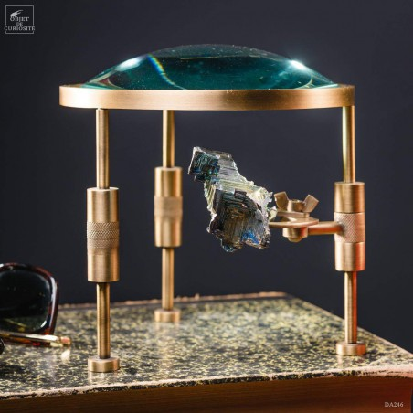 Magnifying glass on stand with bismuth