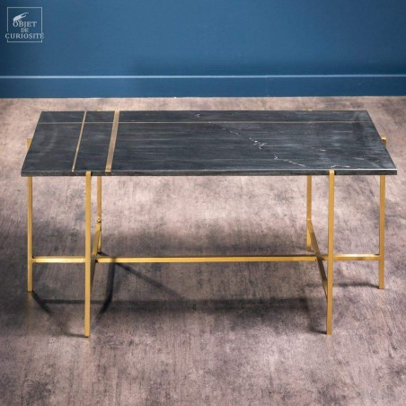 coffee table in black marble with brass lines inlay.