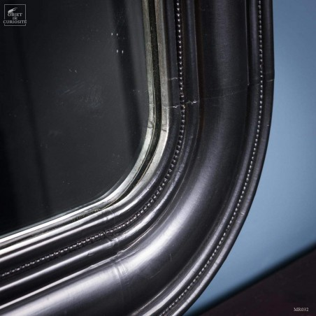 Miroir convexe rond dans cadre carré noir